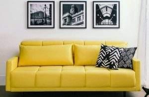 Versatilidade é o sobrenome do Sofá-Cama Apache: que tal ter um sofá amarelo no escritório que também é quarto de hóspedes?